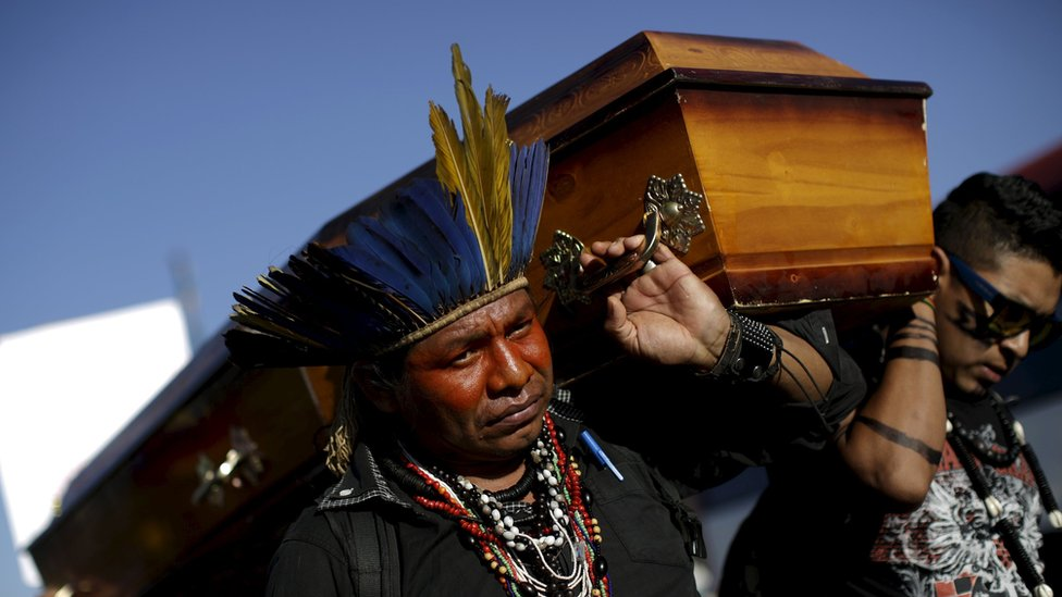 Indigenous leaders protest with a coffin against the murder of the leader of the Guarani Kaiowa ethnicity, Semiao Vilhalva, in Brasilia, Brazil 01 September 2015.