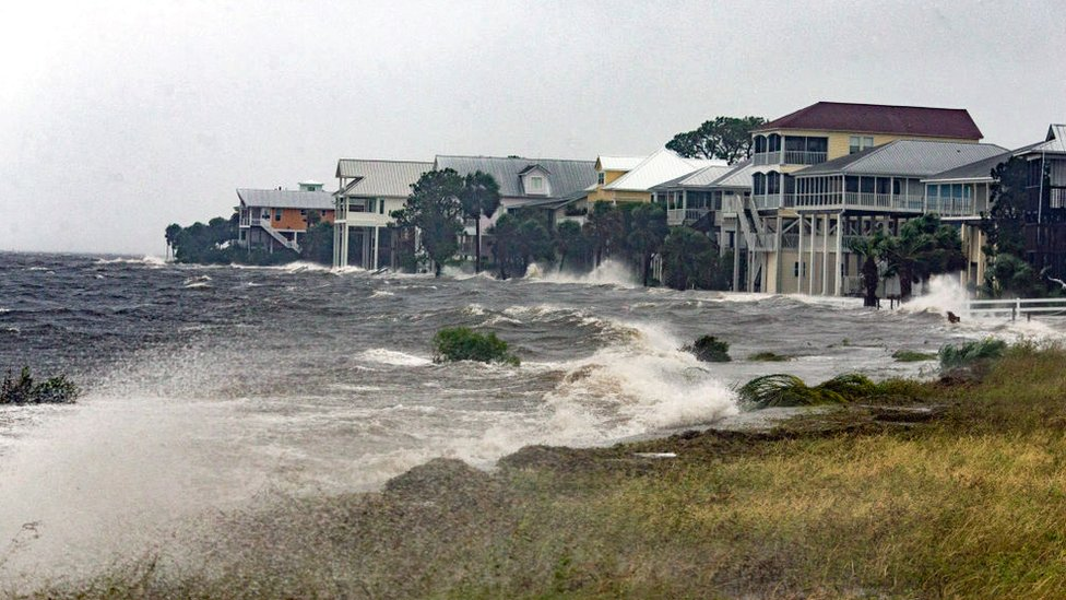 The storm surge and waves from Hurricane Michael batter the beachfront homes on October 10, 2018 in Florida