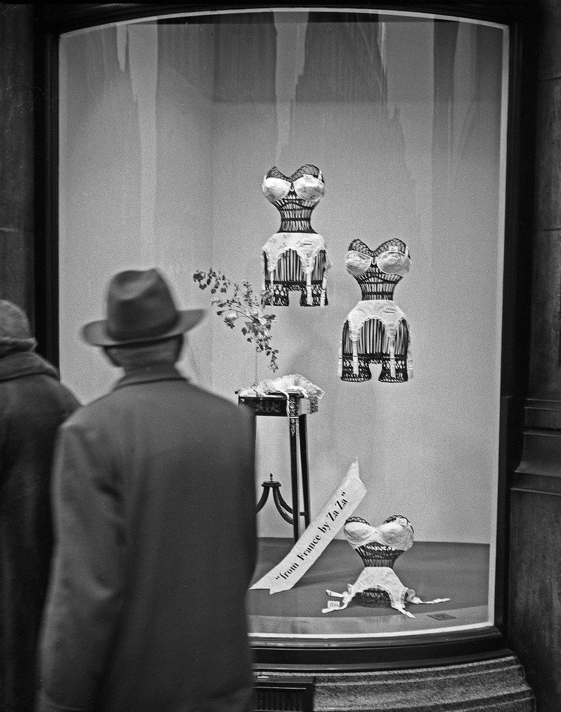 Man looking at ladies underwear in shop window, Bond Street, London, 1960