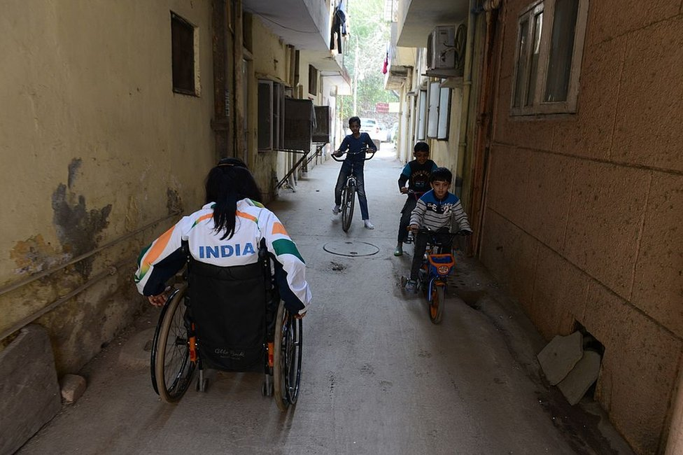 Disabled Indian sportswoman Deepa Malik leaves her home in New Delhi on March 5, 2014, for a athletics practice session.