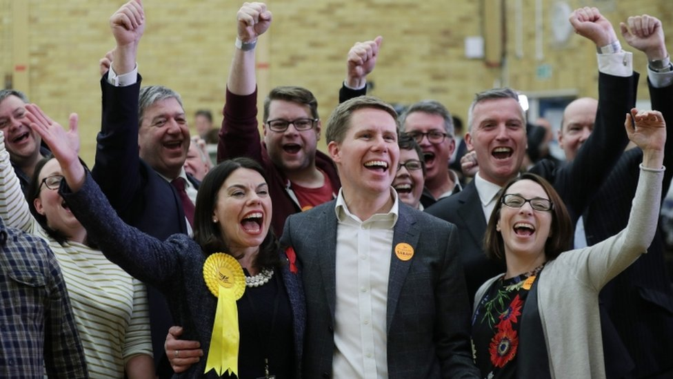 Sarah Olney with her husband Ben and Lib Dem supporters