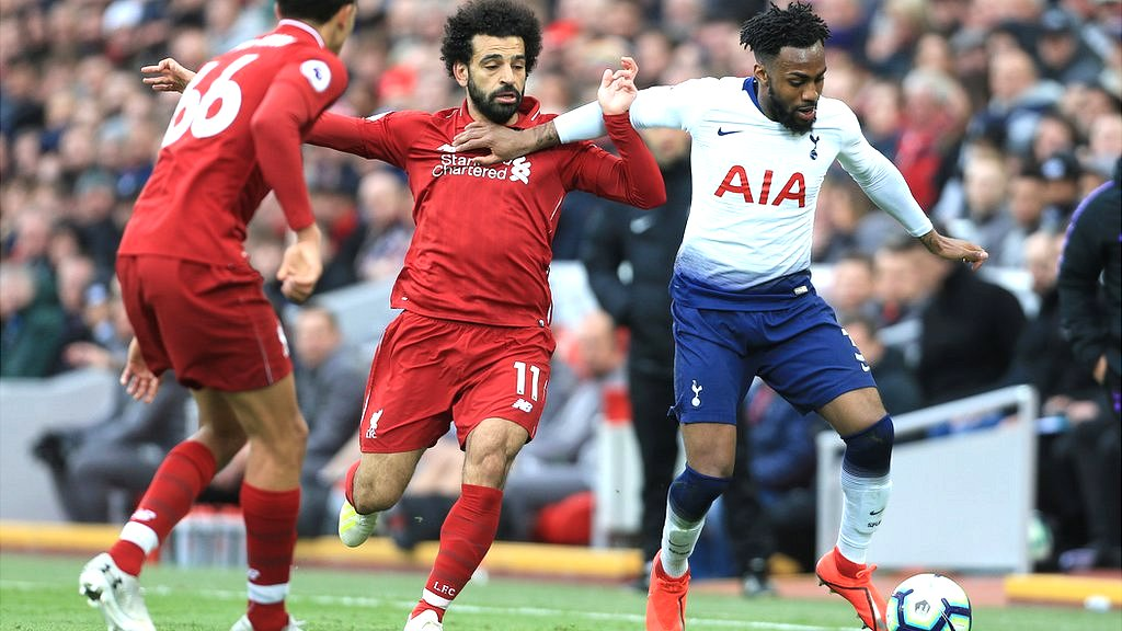 Danny Rose of Spurs tussles with Mo Salah of Liverpool