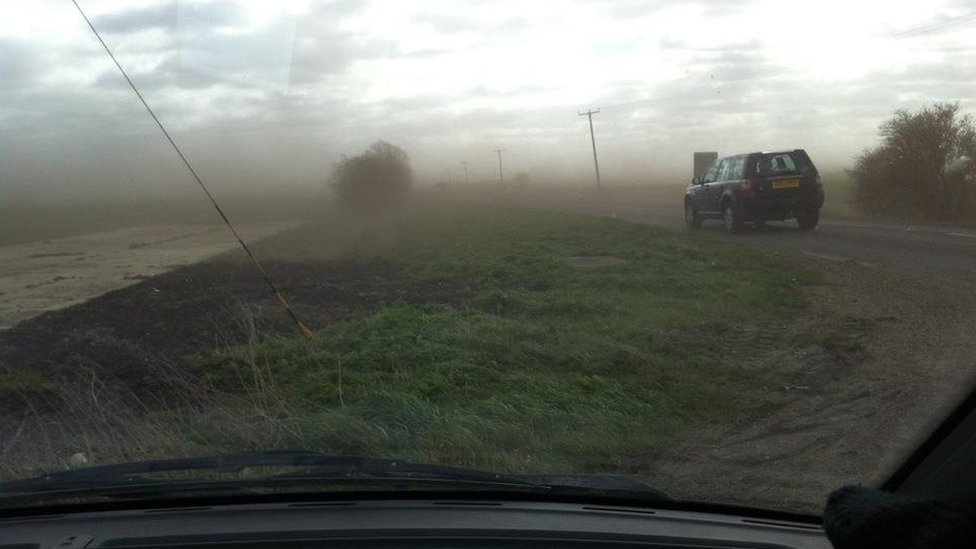 Mud blown across a road in Cambridgeshire