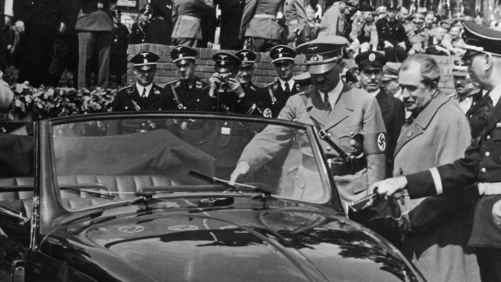 "Nazi leader Adolf Hitler (1889 - 1945) inspects the new, Volkswagen ""people's car"" at the Fallersleben car factory, 27 May 1938"