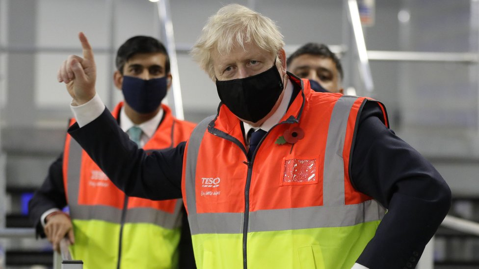 Prime Minister Boris Johnson alongside Chancellor of the Exchequer Rishi Sunak during a visit to the Tesco Erith distribution Centre in south east London.