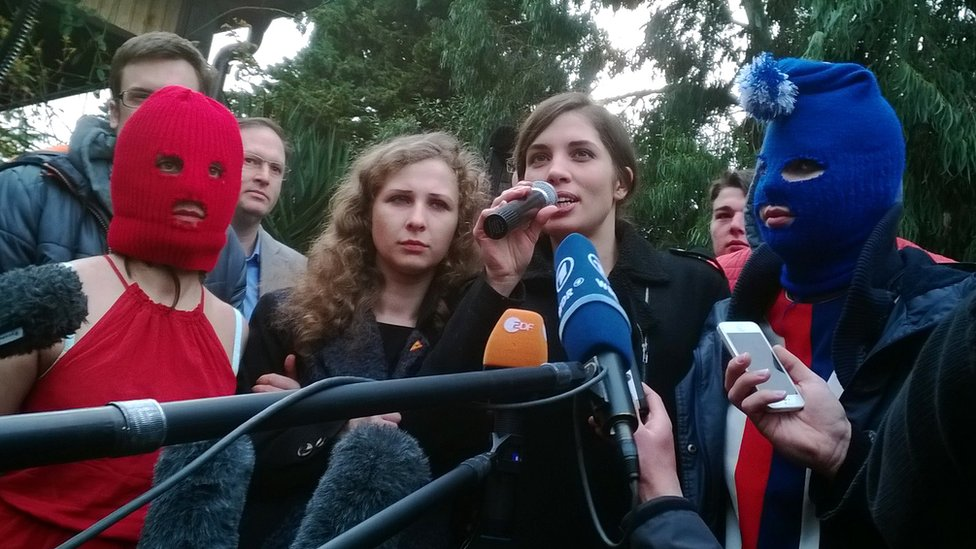Nadezhda Tolokonnikova (R) and Maria Alyokhina speak to the press with fellow Russian punk group Pussy Riot members on February 20, 2014 in Sochi