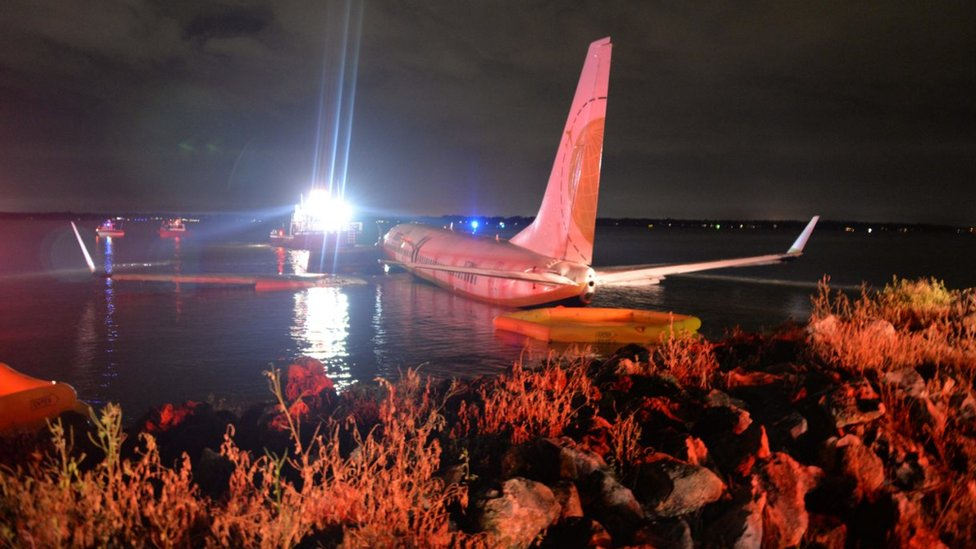 A Boeing 737 aircraft sitting on the water