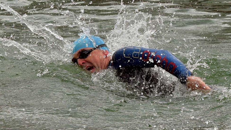 Paul Pester swimming during a triathlon
