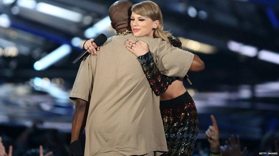 Kanye West and Taylor Swift hug