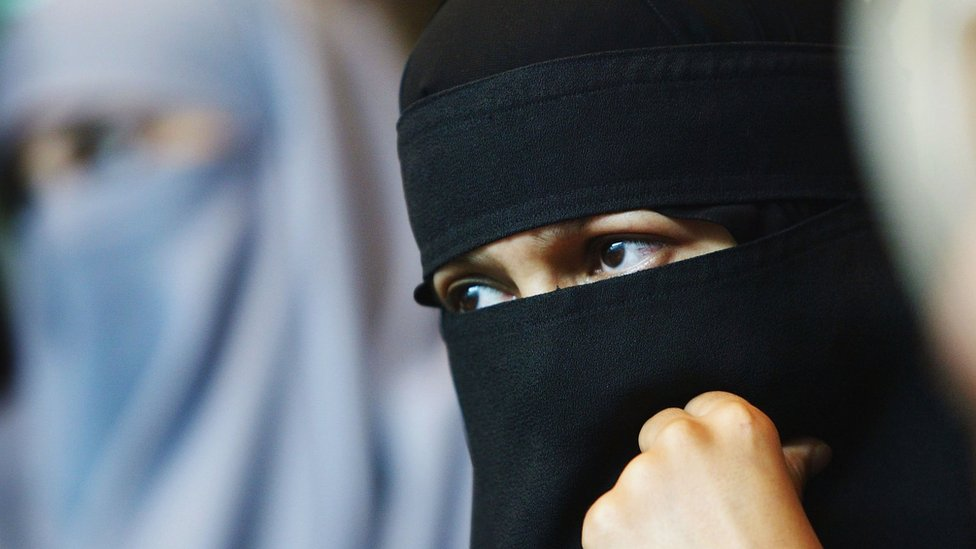 A Muslim woman with a veil attends the 'A woman's right to choose' conference on 12 July 2004 in London. T