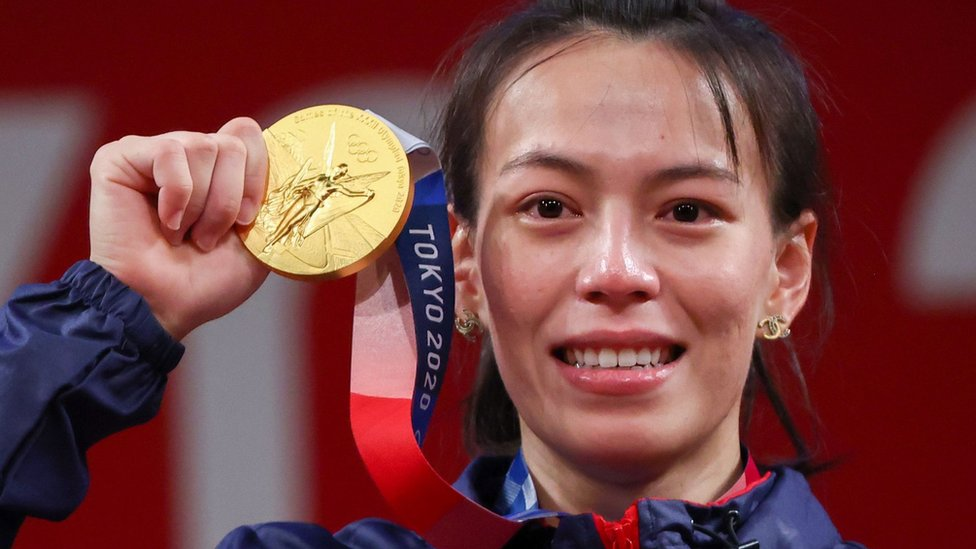 """Tokyo 2020 Olympics - Weightlifting - Women""""s 59kg - Medal Ceremony - Tokyo International Forum, Tokyo, Japan - July 27, 2021. Gold medalist Kuo Hsing-Chun of Taiwan reacts."""