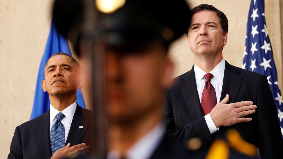 President Barack Obama and new FBI Director James Comey place their hands over their hearts during an installation ceremony for Comey at FBI Headquarters in Washington on 28 October, 2013.