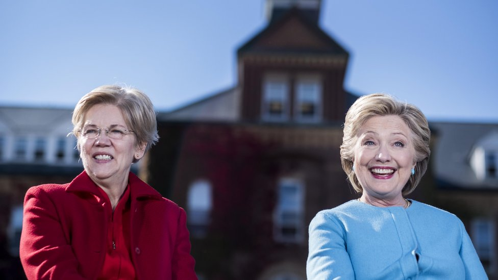 Elizabeth Warren sits next to Hillary Clinton at a campaign event in 2016