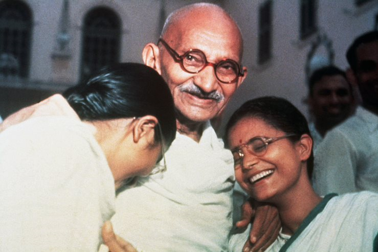 Mahatma Ghandi enjoys a laugh with his two granddaughters, Ava and Manu