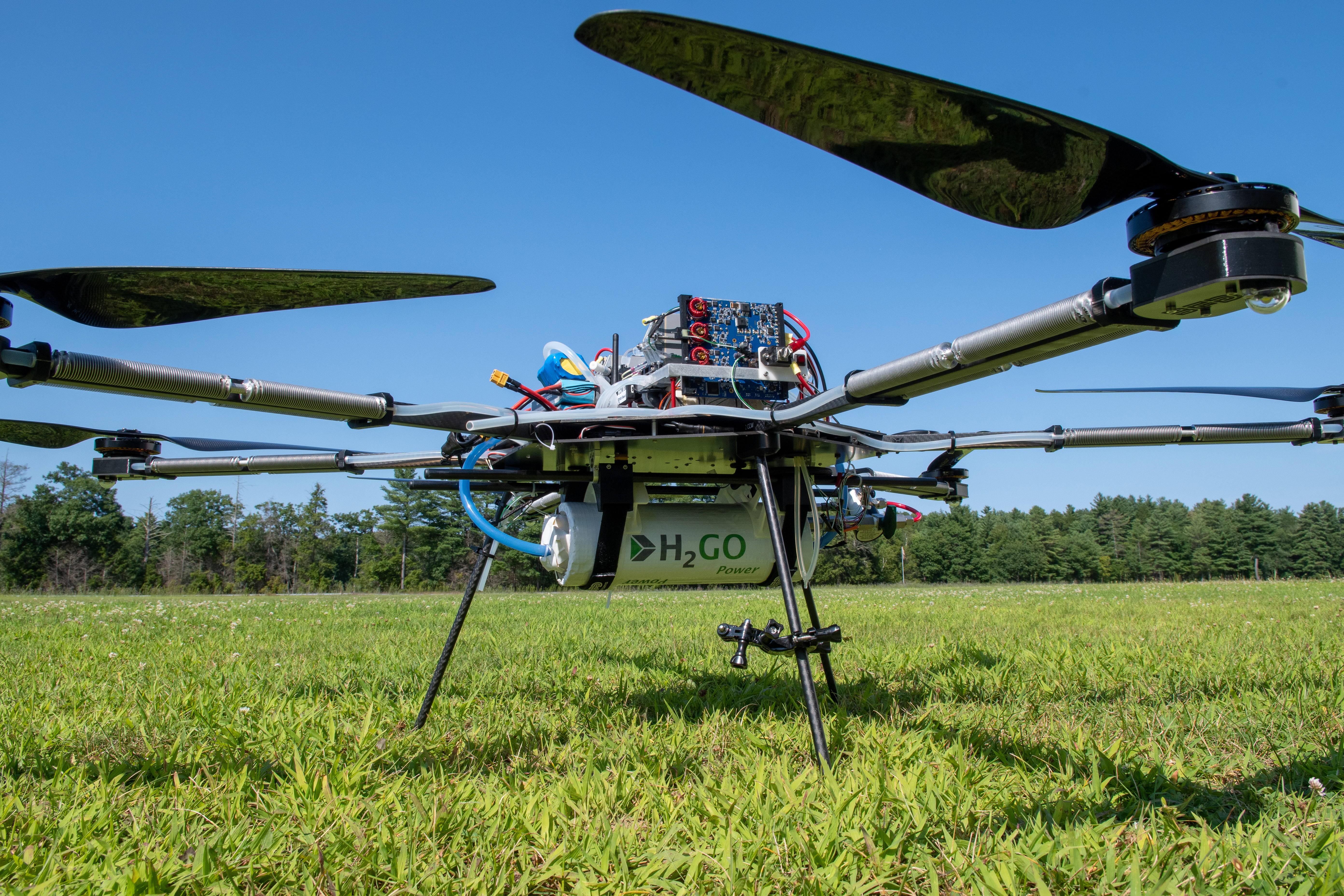 Drone on ground with hydrogen tank and wiring exposed