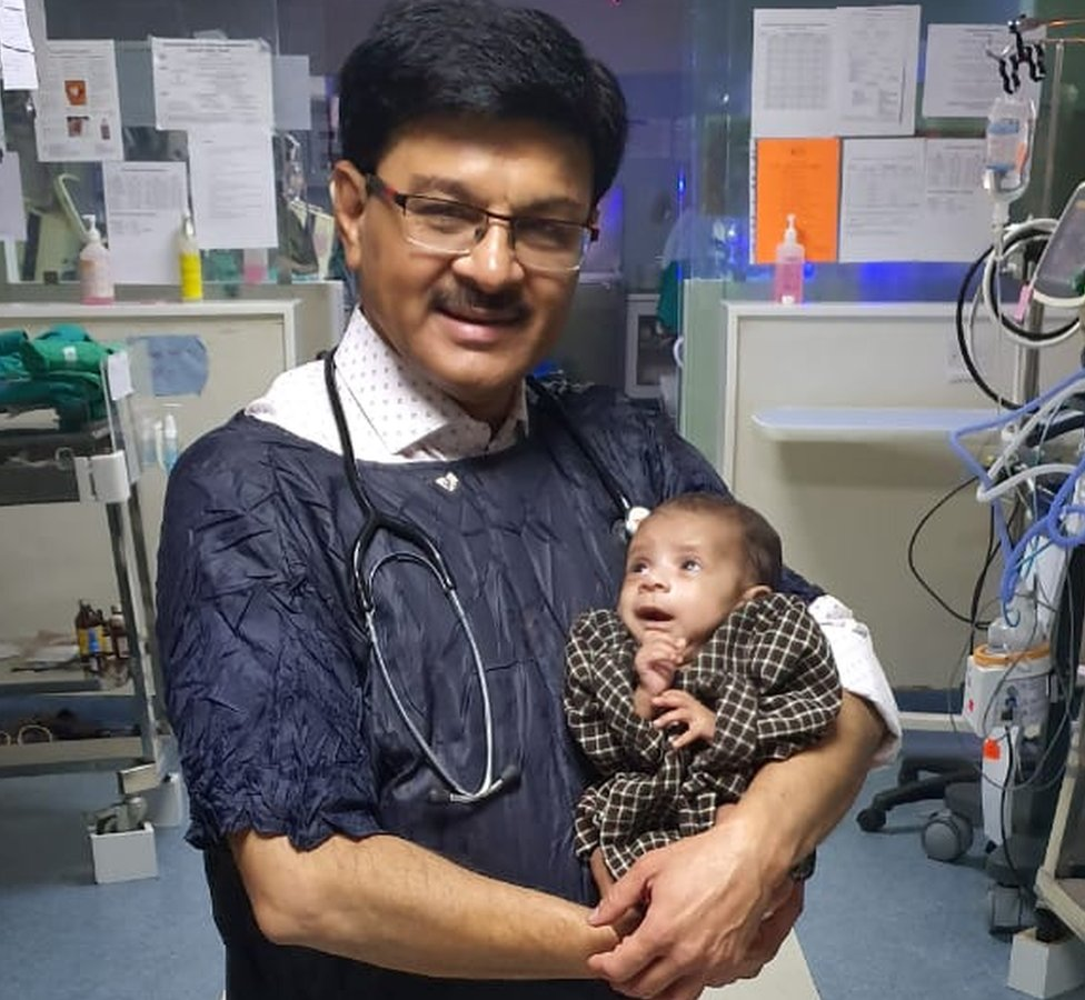 Dr Ravi Khanna with the baby in his hospital