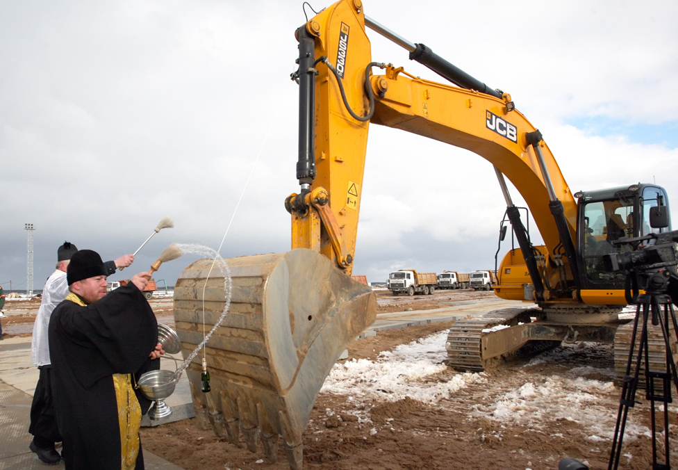 An Orthodox priest blesses an excavator on the construction site of the Belarusian nuclear power plant near the town of Ostrovets, some 18 km from Minsk, 1 February 2013