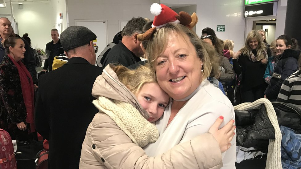 Host families waited at Gatwick airport on Friday to welcome the slightly delayed group of children