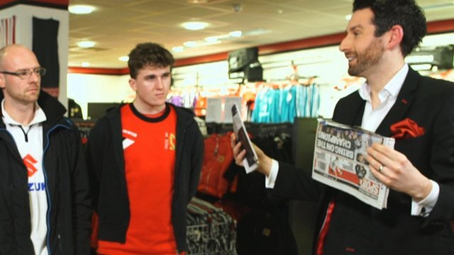 Magician Jamie Raven performs to MK Dons fans