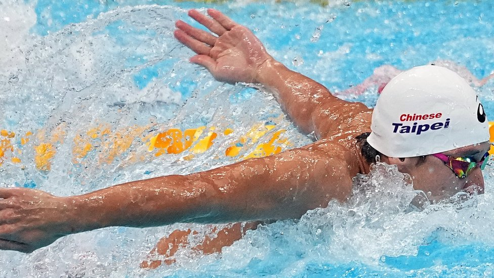 """Kuan-Hung Wang of Chinese Taipei competes in the Men""""s 100m Butterfly Heat 3 during the Swimming events of the Tokyo 2020 Olympic Games at the Tokyo Aquatics Centre in Tokyo, Japan, 29 July 2021"""
