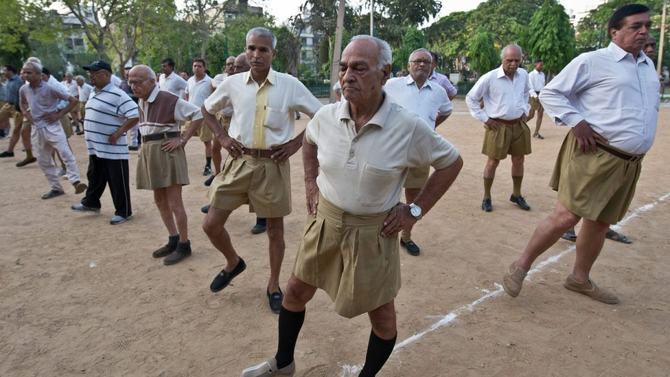 Indian senior swayamsevaks, or volunteers, from the Rashtriya Swayamsevak Sangh (RSS), the country's biggest grassroots religious group, excercise during the Shakha