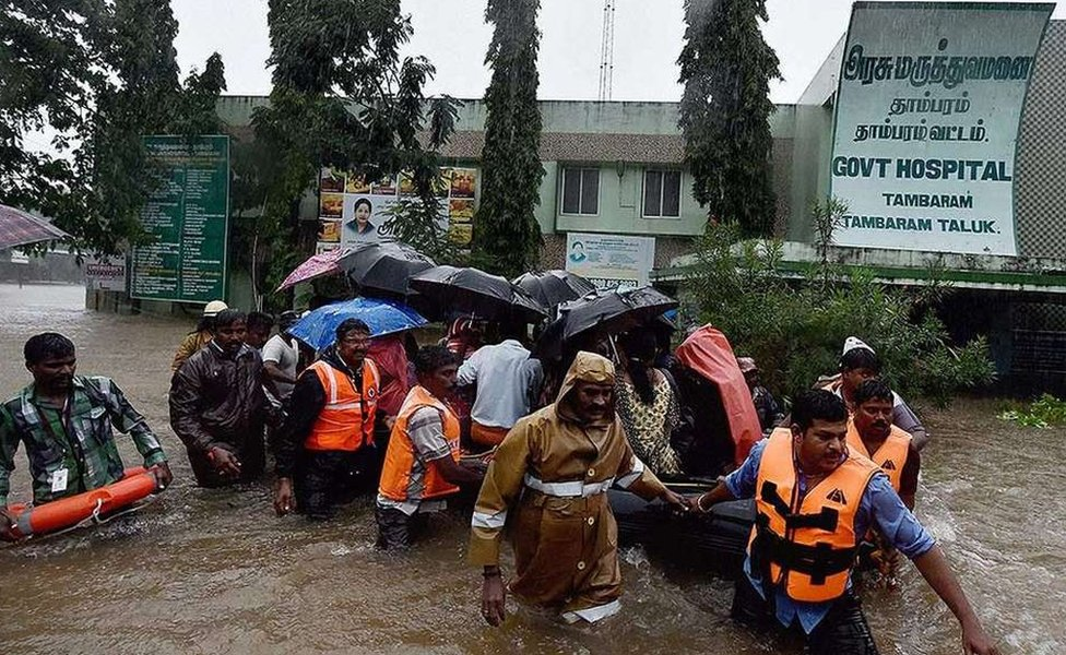 Rescuers shifting patients from a flooded hospital after heavy rains in Chennai.