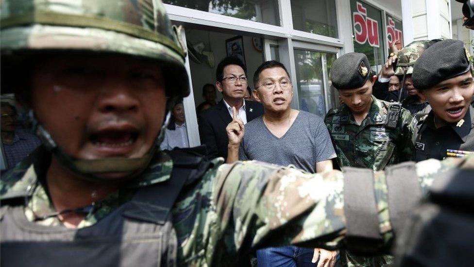 Politician Watana Muangsook arriving at a military base in Bangkok, Thailand