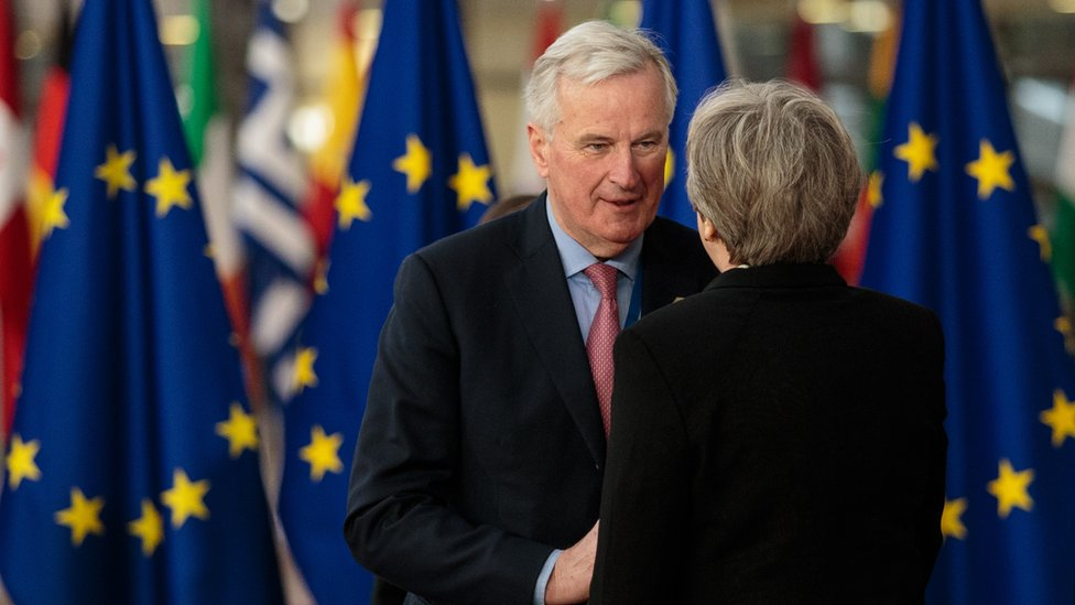 The EU's chief Brexit negotiator Michel Barnier greets British Prime Minster Theresa May at the Council of the European Union, 23 March 2018