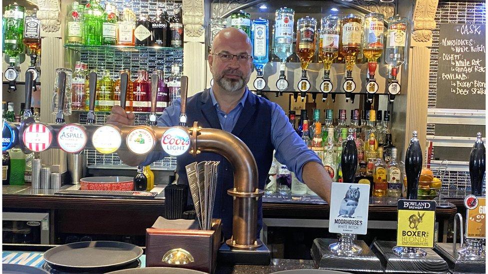 Josh Lee behind the bar at the Thomas Egerton