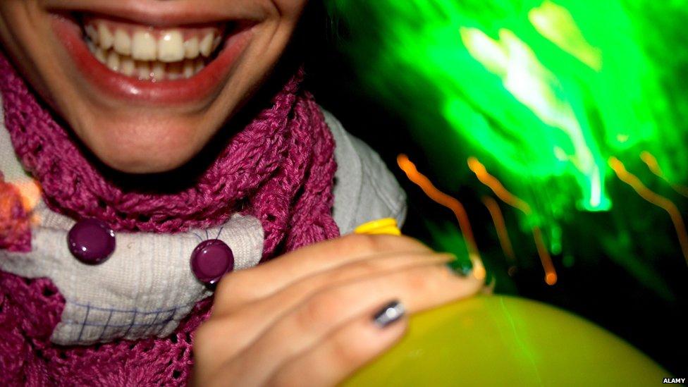 woman taking laughing gas