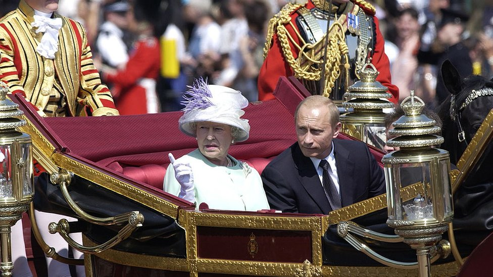 Queen Elizabeth II and Vladimir Putin in a carriage in 2003