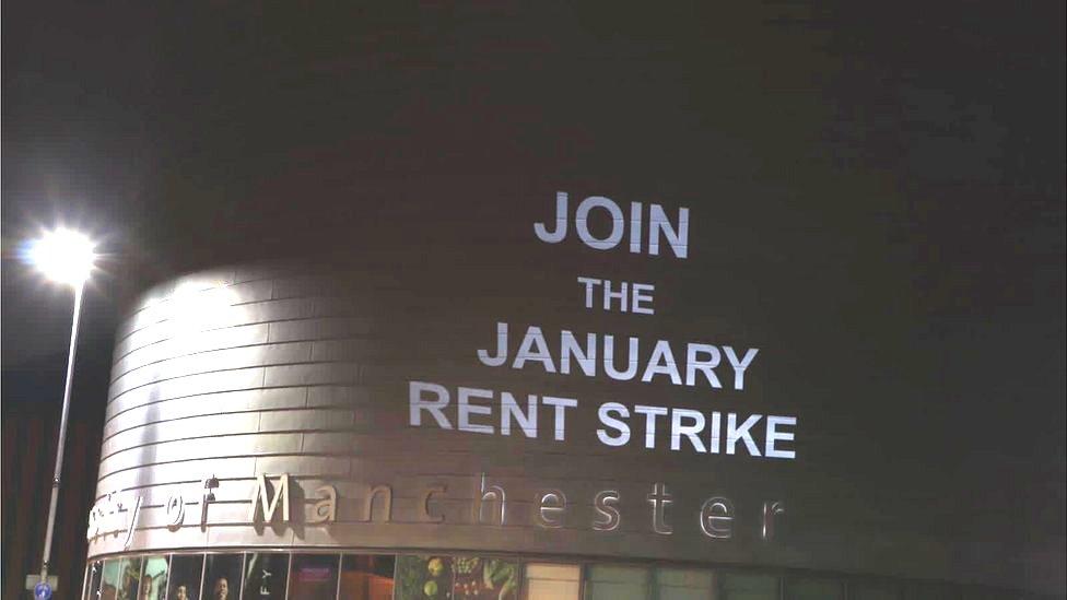 Projection urging rent strike