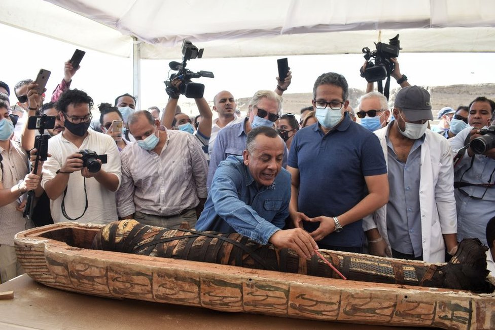 Officials unseal the sarcophagus in front of cameras.