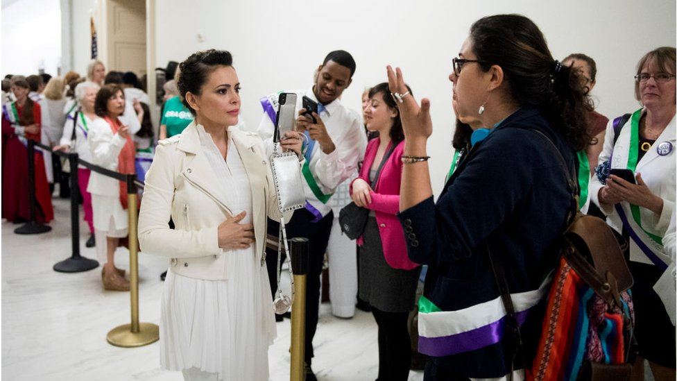Actress Alyssa Milano, using live twitter video, speaks with ERA activists waiting to enter the House Judiciary Constitution, Civil Rights and Civil Liberties Subcommittee hearing on the Equal Rights Amendment on Tuesday, April 30, 2019.