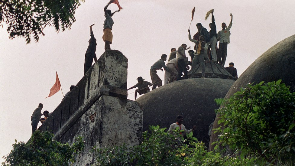 In this file photograph taken on December 6, 1992 Hindu youths clamour atop the 16th century Muslim Babri Mosque five hours before the structure was completely demolished by hundreds supporting Hindu fundamentalist activists.