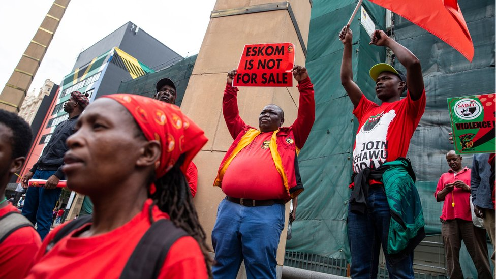 Trade union members protest over reports that the government might break Eskom into three entities