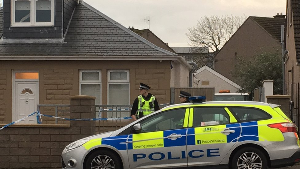 Police outside acid attack house