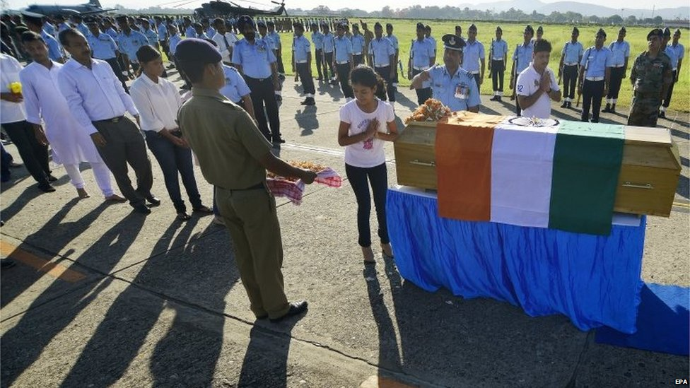 Indian people pay respect to the coffin of former President of India, APJ Abdul Kalam, at an Air Force base in Guwahati, India, 28 July 2015.