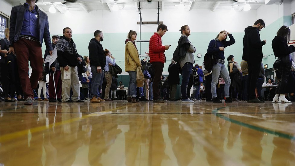 Voters wait in line during voting for the U.S. presidential election in the Brooklyn borough of New York, U.S., November 8, 2016.