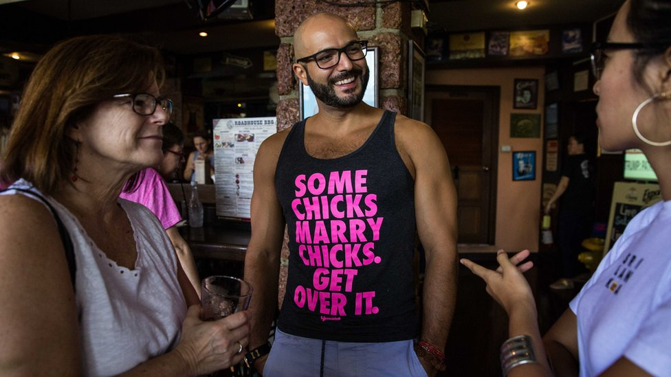 Man wearing T-shirt at event saying 'Some chicks marry chicks, get over it' in Bangkok, Thailand, 21 January 2017