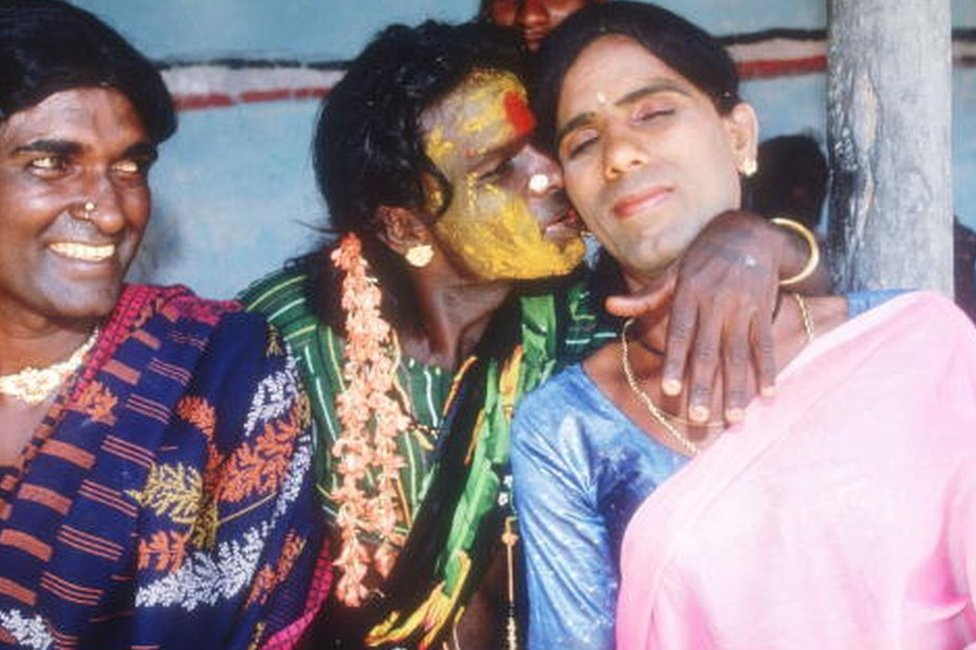 Eunuchs embrace in a hotel room April 24, 1994 in Villupuram, India.