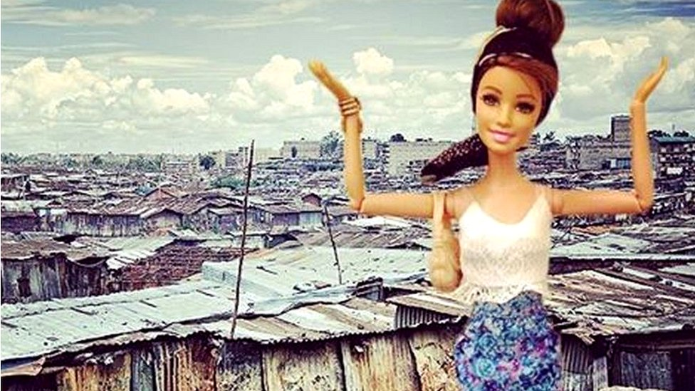 Barbie in front of a slum