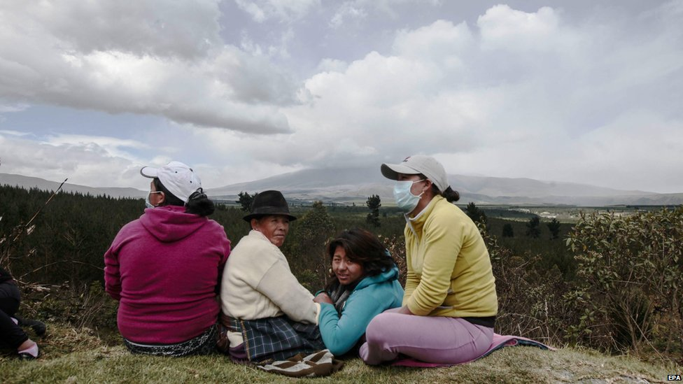 Evacuated inhabitants of Santa Rita town in Cotopaxi province look on at the rumbling volcano on Saturday