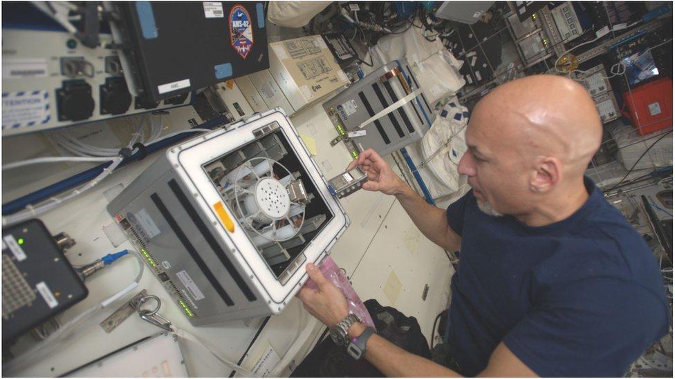The Italian astronaut Luca Parmitano runs the BioRock experiment on the ISS