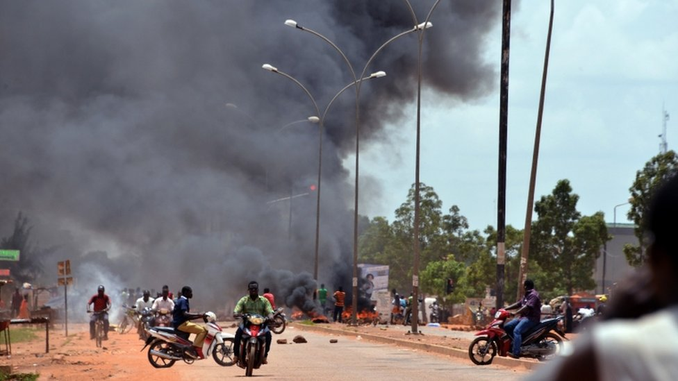 Residents burn tires along a street in Ouagadougou on September 17, 2015