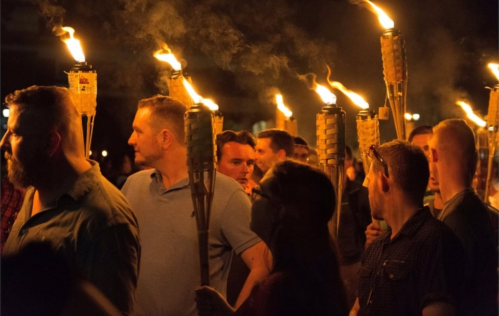 White nationalists carry torches on the grounds of the University of Virginia, on the eve of a planned Unite The Right rally in Charlottesville, Virginia, U.S. August 11, 2017.