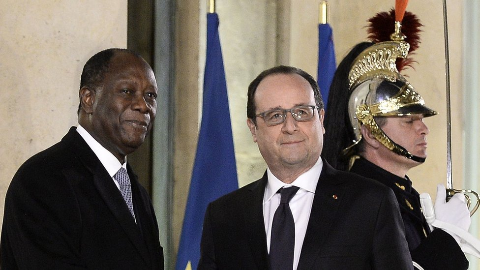 "French President Francois Hollande (C,R) welcomes Ivory Coast""s president Alassane Ouattara prior to their meeting on February 4, 2016 at the Elysee Presidential Palace in Paris."