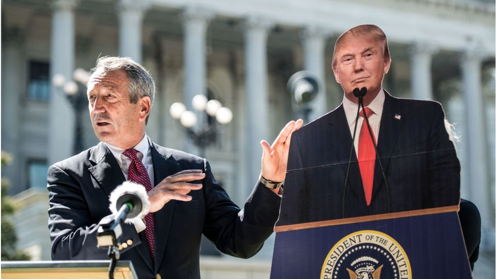 Mr Sanford speaking during his campaign alongside a cardboard cutout of Mr Trump
