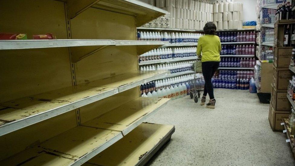 Empty shelves in Caracas supermarket