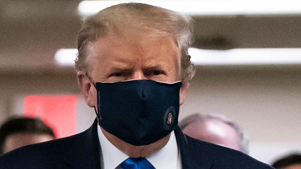 US President Donald Trump, shown at Walter Reed National Military Medical Center in Bethesda, Maryland, in July, has been reluctant to wear a mask